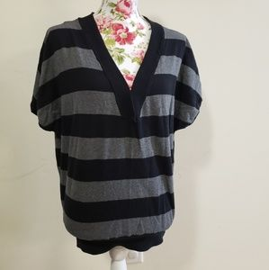 Striped V neck sweater. Size L
